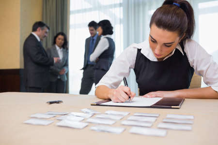 Businesswoman working at welcome desk at conference photo