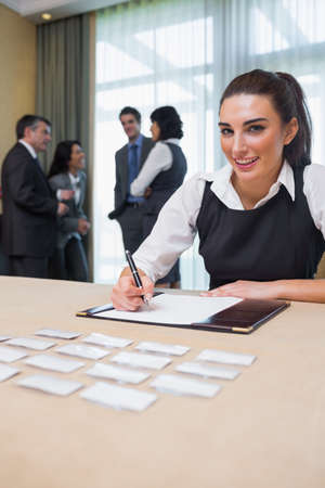 Happy woman at welcome desk at business conference Stock Photo - 18120475