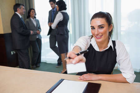 Happy woman handing you a name tag at business conference Stock Photo - 18120594