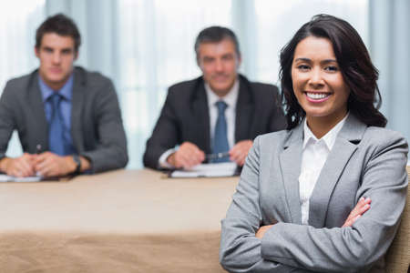 Smiling woman with interview panel in conference room Stock Photo - 18120563
