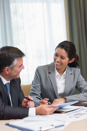 Business people happily talking during meeting photo