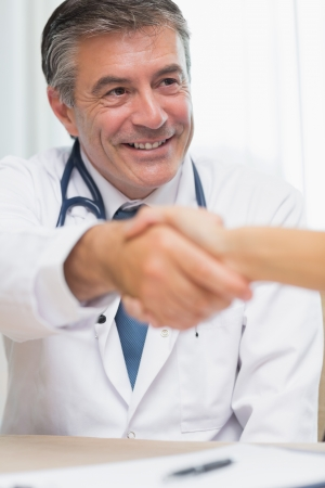 Doctor shaking hands at a meeting photo