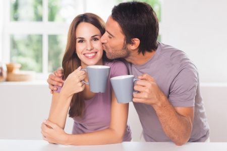 hot kiss: Man kissing his girlfriend with coffee