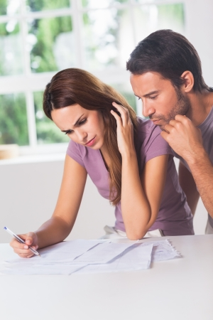 Couple doing their accounting in house Stock Photo - 18122492