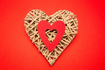 paper cut out: Wicker heart ornament with red paper cut out Stock Photo