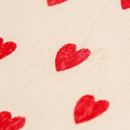 pale wood: Red love hearts painted on pale wood Stock Photo