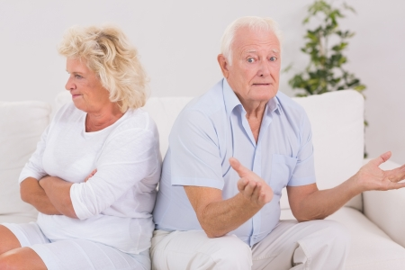 Woman being angry against a missunderstanding man on the sofa Stock Photo - 18125575
