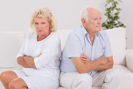 Elderly woman being angry against a man on the sofa photo