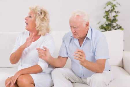 Elderly couple quarrelling on the sofa Stock Photo - 18125744
