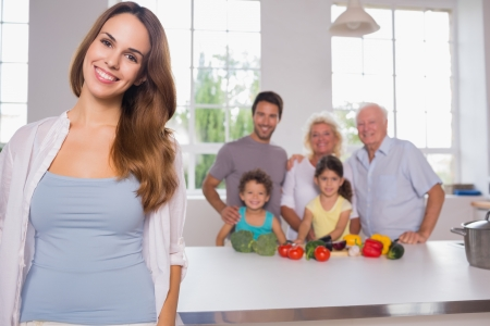Mother in front of her family in the kitchen photo