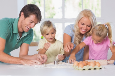 Family cutting the dough for cookies Stock Photo - 18125934