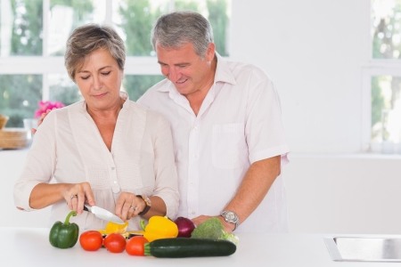 Old couple preparing vegetables in kitchen  photo