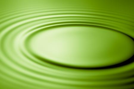 ripple effect: Green ripple effect in water