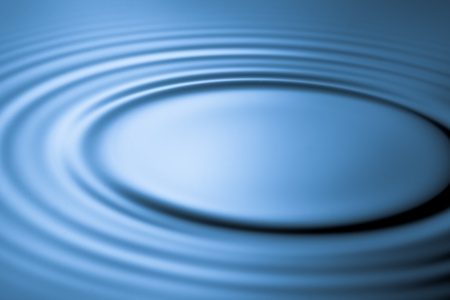 ripple effect: Blue ripple effect in water
