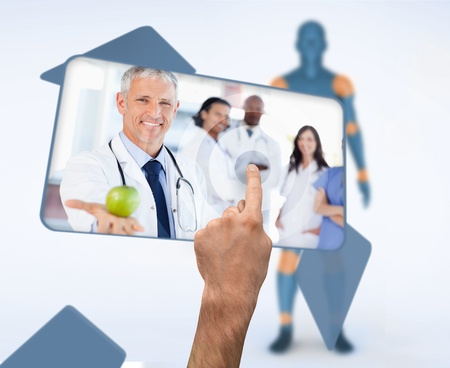 selecting: Hand selecting image of doctor holding apple in digital interface witn human figure Stock Photo