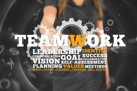 buzz: Businesswoman touching business buzz words on grey digital background Stock Photo