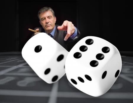 gambler: Gambler at the poker table throwing digital dice in foreground