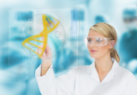 Doctor consulting DNA helix diagram on touchscreen display during surgery Stock Photo - 18132457