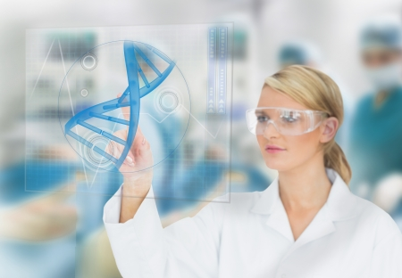 Doctor consulting touchscreen displaying DNA helix diagram during surgery Stock Photo - 18132788