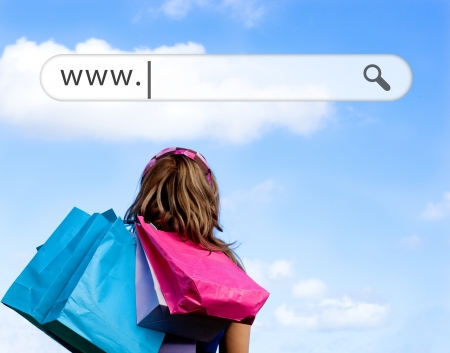 woman shopping bags: Girl holding shopping bags with address bar above against a blue sky