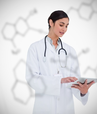 Doctor using tablet pc on chemical formula background in white photo