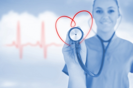 Happy nurse holding up stethoscope to heart design in blue tint on background of blue sky and ECG line Stock Photo - 18132123
