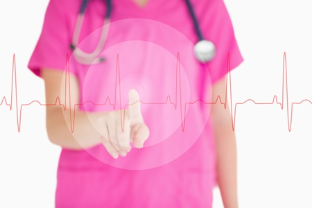Nurse in pink scrubs touching red ECG line on white background Banco de Imagens - 18132240