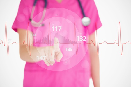 Nurse in pink scrubs touching red ECG line with figures on white background Banco de Imagens - 18132267