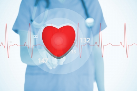 Nurse in scrubs touching red ECG line with heart graphic on white background photo