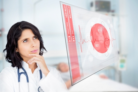 ward: Doctor studying virtual screen showing ECG line in hospital ward Stock Photo