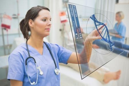 hospital ward: Nurse touching screen displaying blue DNA helix data in hospital ward