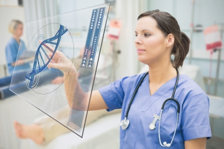 ward: Nurse touching screen showing blue DNA helix data in hospital ward Stock Photo