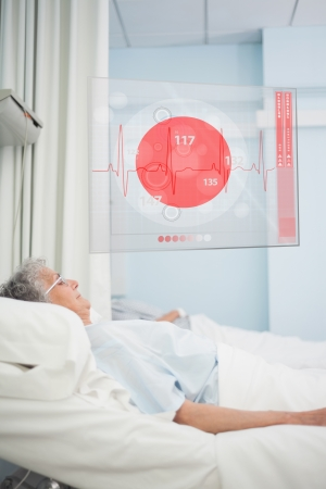 hospital ward: Elderly patient lying in hospital bed with futuristic ECG data display in a hospital ward