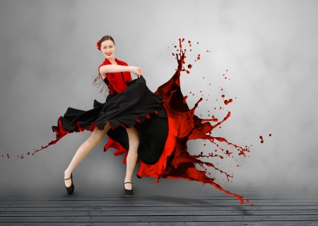 Flamenco dancer with dress turning to paint splattering on grey floorboard background photo