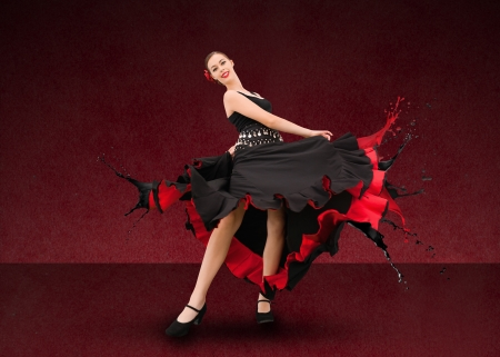 Flamenco dancer with dress turning to paint splatter on deep red background Stock Photo