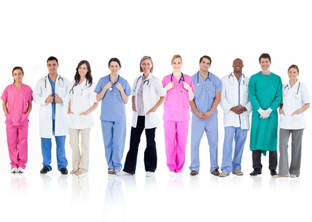 Happy team of doctors standing together in a line on a white background photo