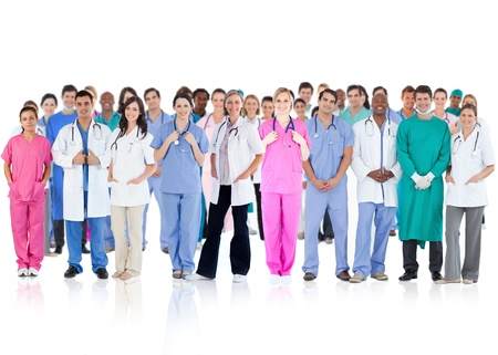 Happy team of smiling doctors standing together on a white background