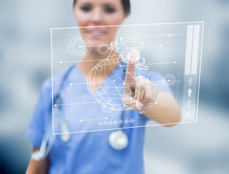 Female cardiologist touching a medical interface in the hospital photo