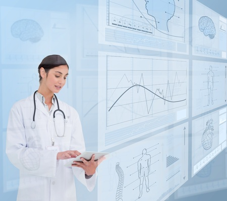 scrolling: Woman doctor using a tablet pc near to futuristic screens