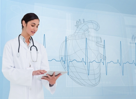 Cheerful cardiologist using a tablet pc in front of heartbeat line photo