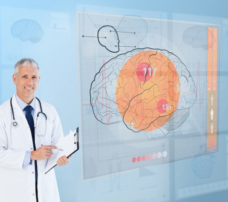 Smiling doctor using a futuristic interface for brain analysis photo