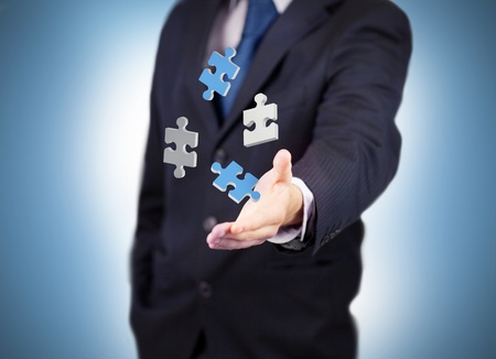levitating: Businessman with digital white and blue puzzles levitating