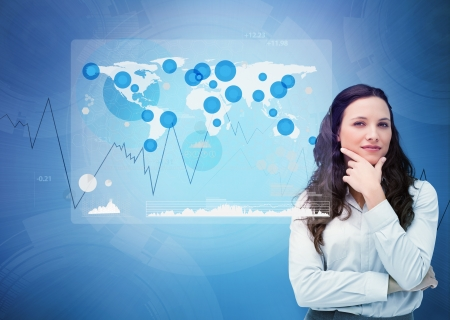Businesswoman looking at digital futuristic interface with a Hand using screen with world map photo