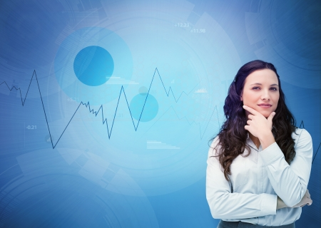 Businesswoman looking away against a digital blue background photo