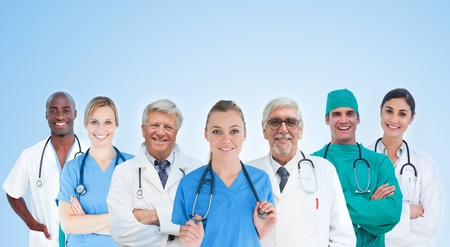 Medical team standing in line on blue background and smiling photo