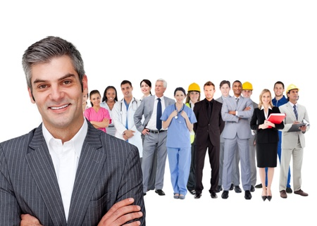 Smiling businessman ahead a group of people with different jobs on white background photo