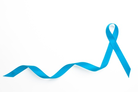 Blue awareness ribbon with trail on white background photo