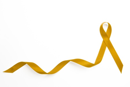 Yellow awareness ribbon with trail on white background photo