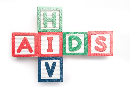 hiv: Wood blocks spelling aids and hiv in a cross shape on its side on white background Stock Photo