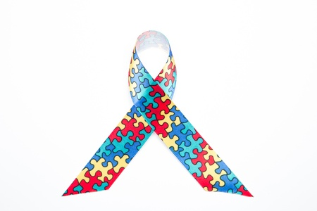 Awareness ribbon for autism and aspergers on white background photo